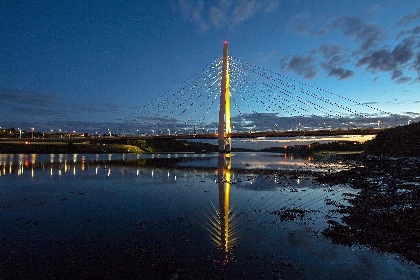 Northern Spire bridge lit yellow