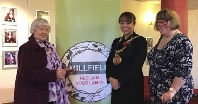 6 November 2018 - I awarded Mrs Sanderson £100 shopping vouchers as part of the Reclaim Your Lanes project. Hundreds of householders have been visited as part of the project which encourages neighbourliness.