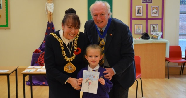 7 November 2018 - I visited St Joseph's RC Primary School to pick the winner of my Christmas Card Competition. The winner was five-year-old Lilia Dobbing, who drew a colourful snowman as part of her Christmas card design.